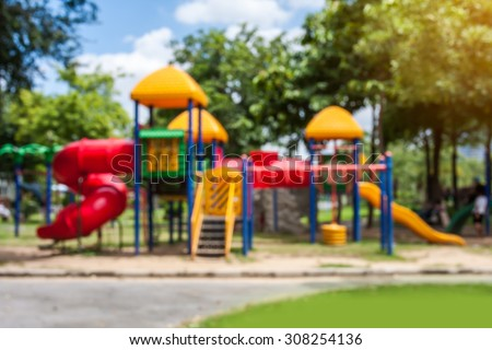 blurred of playground on day noon light in city park. - stock photo