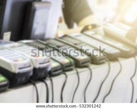 Blurred of Stack of Credit Card Machine In The Store : Selective Focus