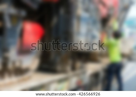 Blurred of Sugar cane harvesters on trailer truck for move to work. - stock photo