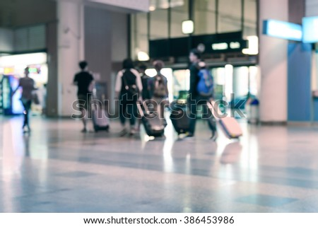 Blurred of travllers walking in airport lounge.