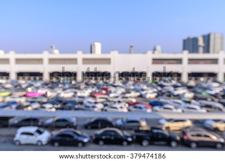 Blurred of urban outdoor car park in daytime. - stock photo