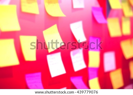 Blurred or de-focus colorful paper notes on the walls,Blurred background concept. - stock photo
