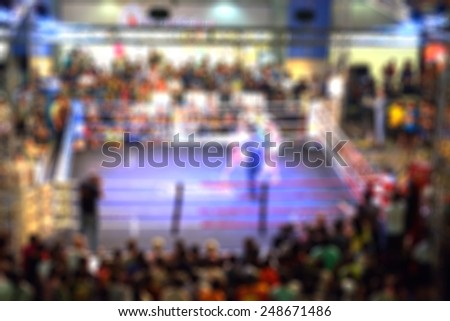 Blurred or defocus image of Thai Boxing Competition in Bangkok, Thailand. - stock photo