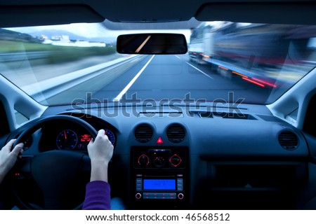 Blurred overtaking from inside vehicle, unrecognizable driver - stock photo