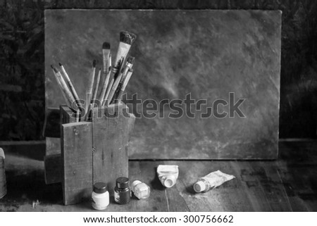 blurred paintbrushes,color and dirty photo flame on wooden background,back white grunge style.  - stock photo
