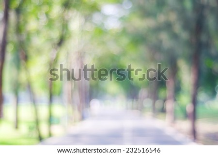 Blurred park with bokeh background - stock photo