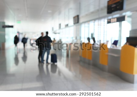 blurred people and airport - stock photo