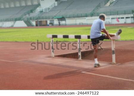 blurred people exercise in stadium - stock photo
