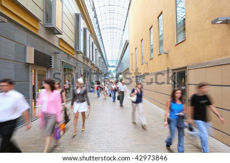 Blurred people going on street - stock photo