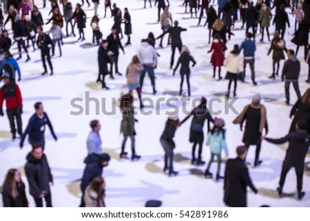 Blurred people ice skating