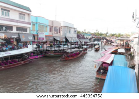 blurred people in floating market for shopping - stock photo