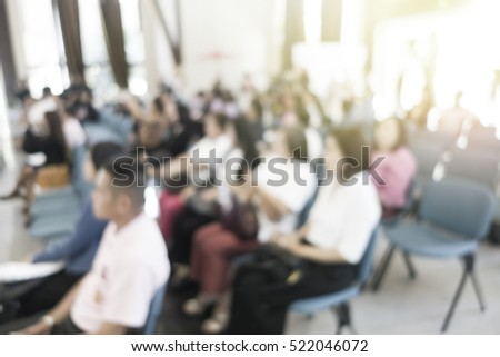 blurred people in seminar room event business concept