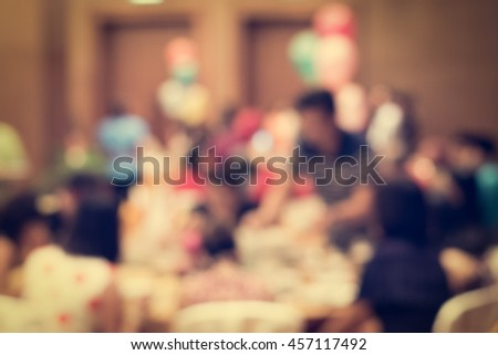 Blurred people in the banquet room with colorful balloon - stock photo
