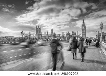 Blurred people moving on Westminster Bridge, London. - stock photo