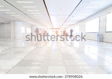 Blurred people on subway platform leaving the train - stock photo
