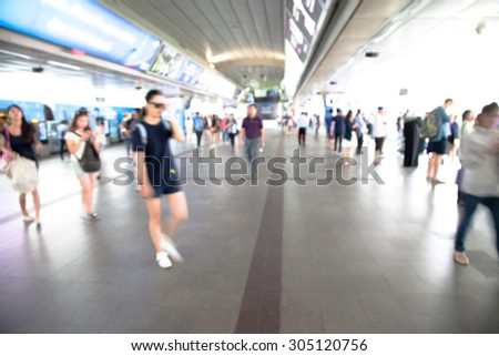 Blurred people on the BTS station in Bangkok.