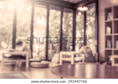 blurred people reading a books in public library in vintage color tone - stock photo