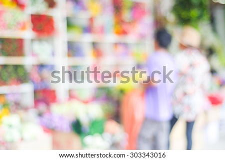 Blurred people shopping at street fair market , blur background, summer flea market - stock photo
