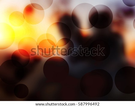 Blurred people sitting on rock with sunset lighting background