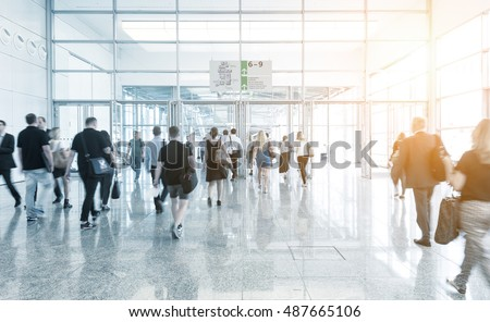 Blurred people using a floor