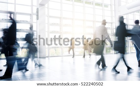 Blurred people walking at a Exhibition floor