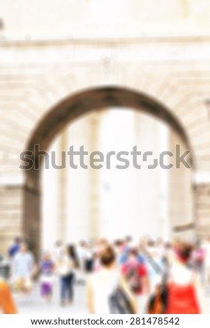 Blurred people  walking on the street - stock photo