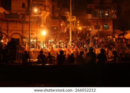 Blurred performance with silhouette during the evening in Varanasi, India - stock photo