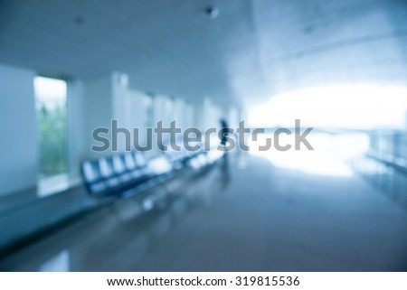Blurred photo of an airport terminal. Blurred background for topics of Industrial architecture and transportation. - stock photo
