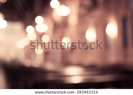 blurred photo of church interior in vintage filter for background - stock photo