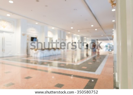 Blurred photo of corridor in modern building, background uses