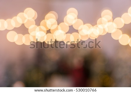 Blurred photo of flashlights in a snow-covered park with spruce trees