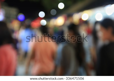 Blurred photo of people promenade at the Thai temples festival is held once a year, according to Thai temples around the country - stock photo
