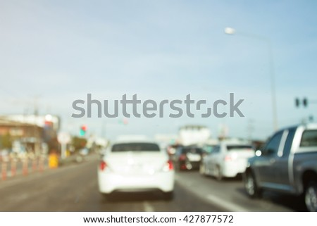 Blurred photo of traffic jam in Thailand. road view of Thailand.  - stock photo