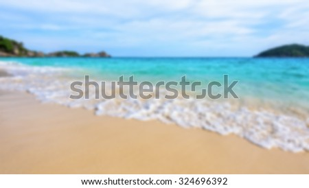 Blurred photograph for background beautiful landscape blue sea and white waves on beach in summer at Koh Miang island, Mu Ko Similan National Park, Phang Nga province, Thailand, 16:9 widescreen