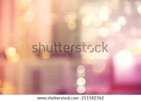 Blurred pink and orange urban building background scene - stock photo
