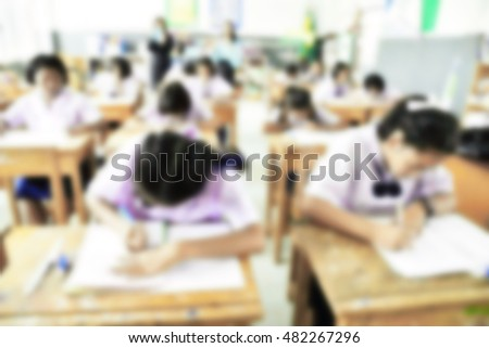 Blurred primary school classroom in Thailand. Blurred students, teachers and team.