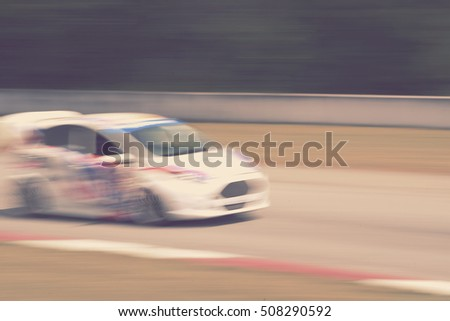 blurred racing car on track - blur background