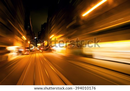 Blurred reflections of a passing vehicle. Evening in the city of abstraction. - stock photo