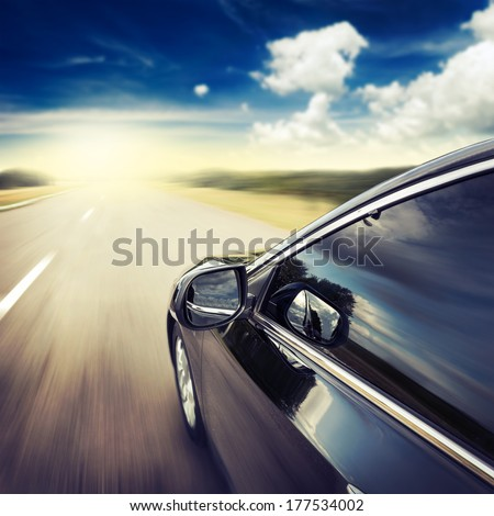 Blurred road and car, speed motion background - stock photo