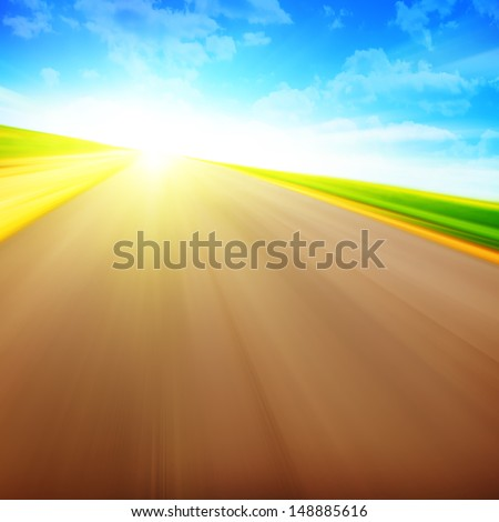 Blurred road at sunset. - stock photo