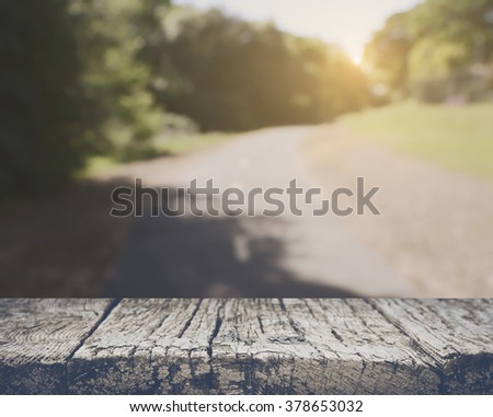 Blurred Road in Forest with Retro Instagram Style Filter - stock photo