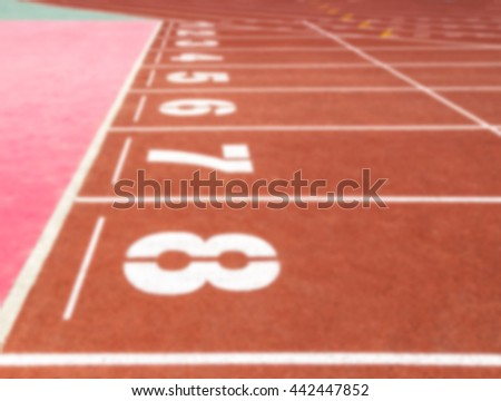 blurred running track with number in stadium  - stock photo