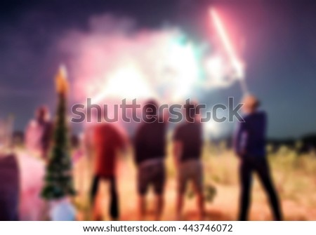 Blurred scene friend celebration playing sparkler on field - stock photo