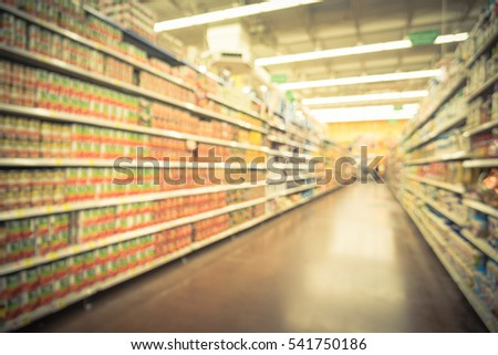 Blurred selection of pasta, ketchup, condiment, tomato sauce and canned vegetable on shelves in store at Humble, Texas, US. Aisle, row variety products, defocused background, bokeh light. Vintage tone