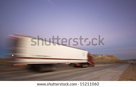 Blurred semi on the road - Wyoming. - stock photo
