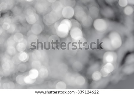 Blurred shiny flickering silver background - stock photo