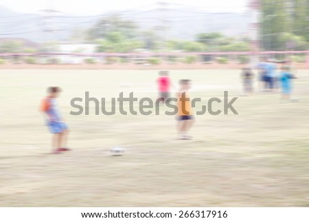 blurred shot of soccer field at school on day time  motion blur image - stock photo