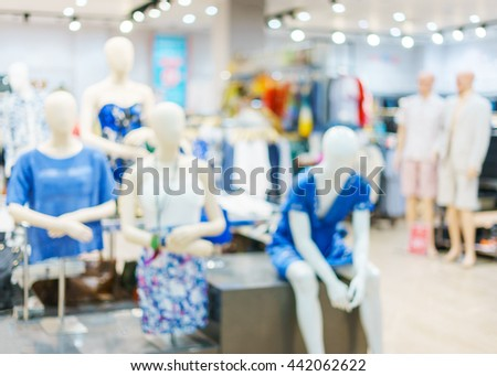Blurred showcases fashion boutique with clothes. Blurred bokeh basic background for design - stock photo