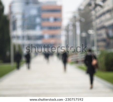 Blurred silhouettes of the people on the street - stock photo