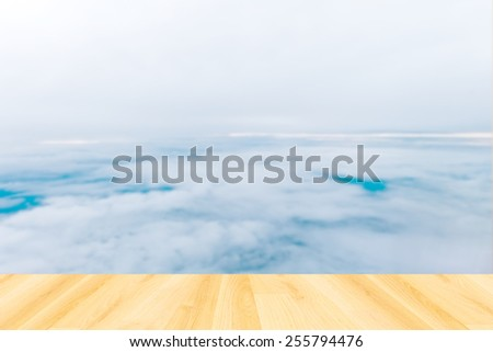 blurred sky background with flare and Wood Floor